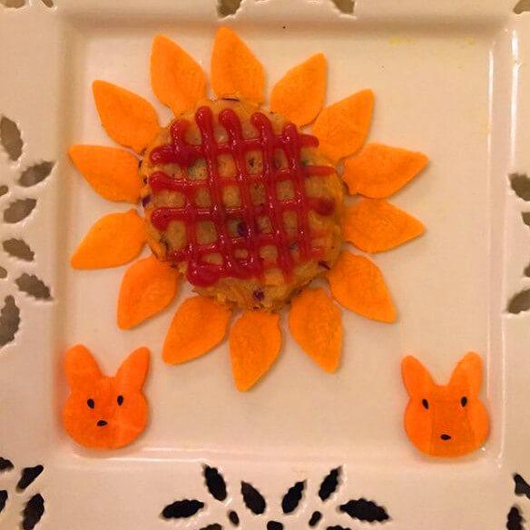 可口的胡萝卜太阳花盆栽
